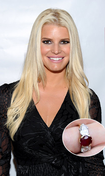 Eric Johnson sought the help of Neil Lane to create his engagement ring to Jessica Simpson – the same designer that his brother-in-law Evan Ross chose for his proposal to Jessica's sister Ashlee Simpson. The rock is made of a central five-carat ruby, flanked by two pear-shaped diamonds on the side.