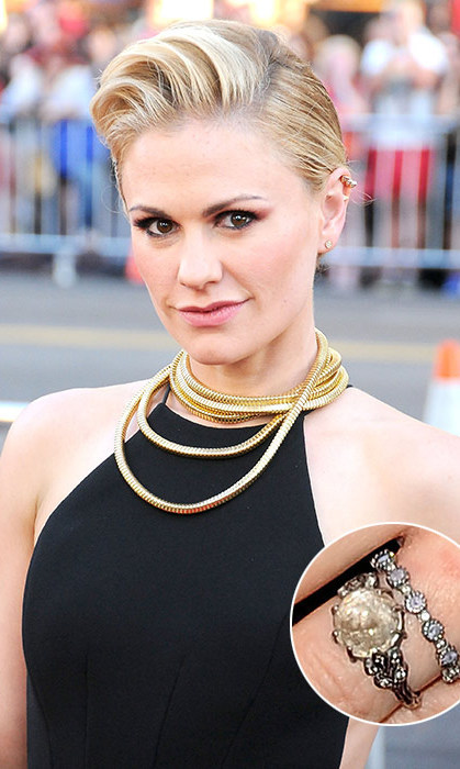 In keeping with her rock chic style, Anna Paquin was presented with a truly unique ring by her 'True Blood' co-star Stephen Moyer. Instead of a traditional diamond, the actress was given a moonstone – said to bring good fortune and success in love.