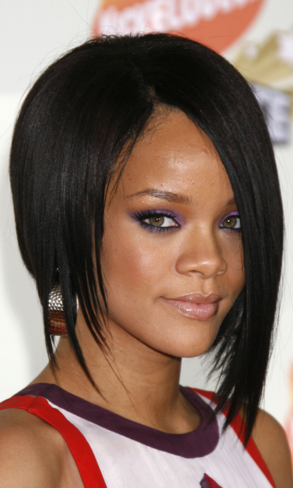 Here in 2007, Rihanna keeps things cool with a chic asymmetrical bob. 
