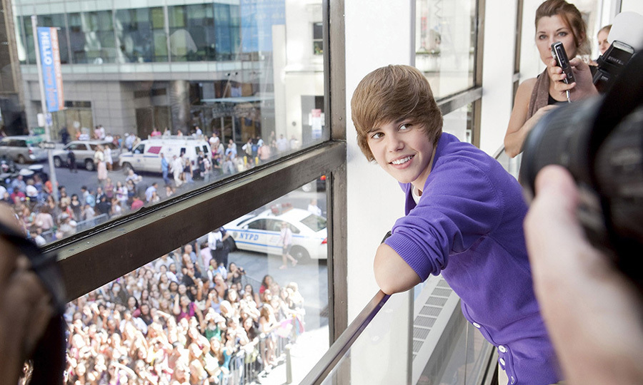 By September of 2009, Justin Bieber was already a megastar. A crowd of fans awaited him during his visit to the Nintendo World in New York City. 