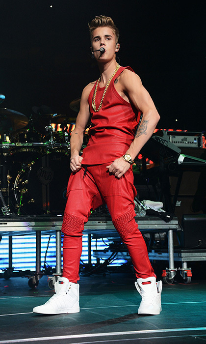 A manlier-looking Justin showed off his newly-buff physique at Q102's Jingle Ball in 2012, sporting a Michael Jackson-inspired, all-red outfit and a large gold chain. 