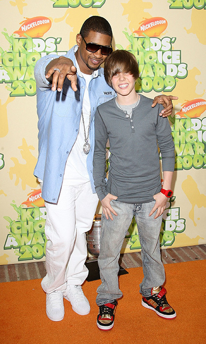 "In 2009, Justin Bieber and his mentor, Usher, arrived at Nickelodeon's 2009 Kids' Choice Awards. Usher once revealed that though he and Bieber were both signed at the same age, ""I had the chance to ramp up my success, where this has happened to Bieber abruptly."" Following Justin's 2014 arrest, Usher flew down to Panama to be by the singer's side, reportedly telling the star: ""You've got a lot of people depending on you."" Photo: © Getty Images"