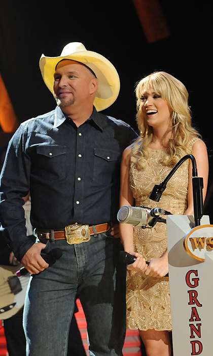 "In 2008, Carrie became a card-carrying member of the prestigious Grand Ole Opry alongside country greats like Reba McEntire and Keith Urban. At the time of her induction (here with Garth Brooks), Carrie said, """"It means a lot to me because it's the heart of country music, the church, the sacred place, the super-elite club that says you love this music""
