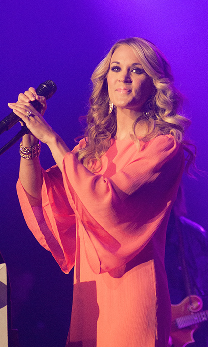 "Carrie has sold more than <strong>65 MILLION RECORDS</strong> over the past 12 years and has racked up <strong>24 NUMBER-ONE SINGLES</strong>, including: ""Before He Cheats"", ""Jesus, Take the Wheel"" and ""Blown Away"". 