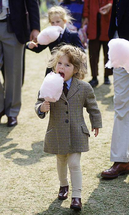 She's got a sweet tooth! Dressed to the nines in a tartan coat paired with a shirt and tie, the princess enjoyed some cotton candy at the Windsor Horse show in 1994.