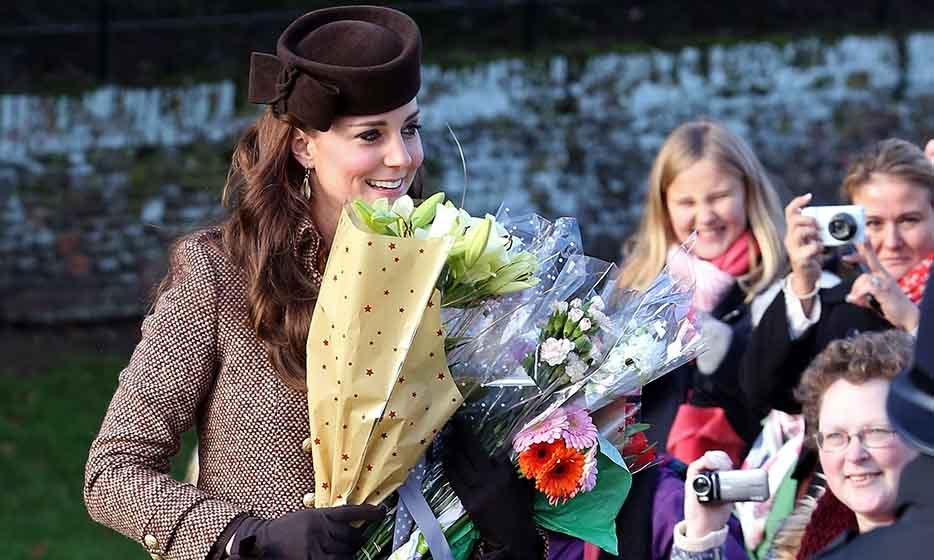 The duchess collected flowers from well wishers as she attended a Christmas Day church service at Sandringham in 2015.