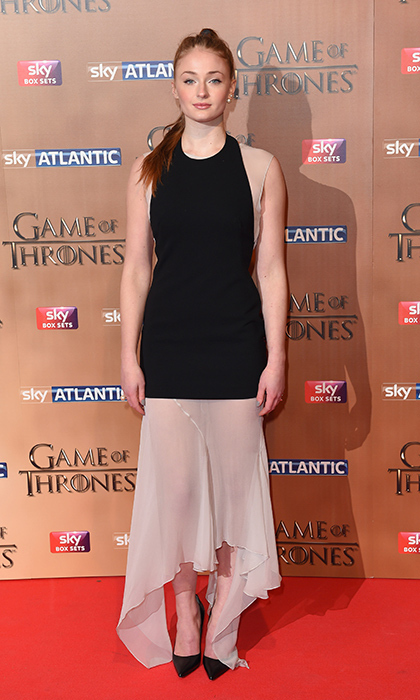 Actress Sophie Turner appeared at the London 'Game of Thrones' premiere in a semi-sheer Mario Schwab dress featuring an asymmetrically cut nude underlay. 