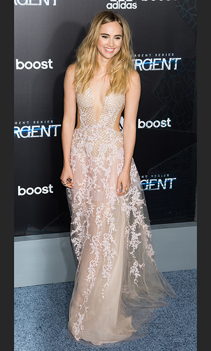 Suki Waterhouse attended the 'Insurgent' New York premiere in a cutout chiffon gown by Reem Acra with lace embroidery.