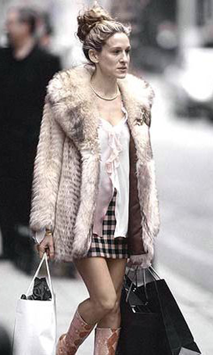 Out shopping in her signature fur coat worn over a mismatched outfit.
