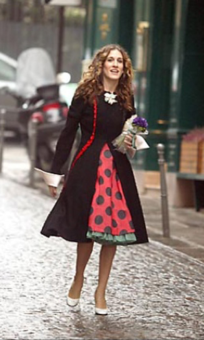 Roaming the streets of Paris in a très chic polka-dotted dress featuring oversized cuffed sleeves.