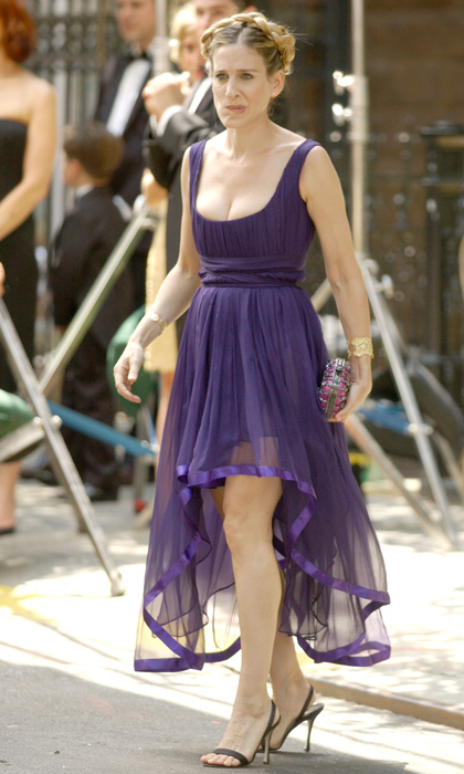 Showing off her décolletage in a low-cut purple dress for Charlotte'es second wedding.