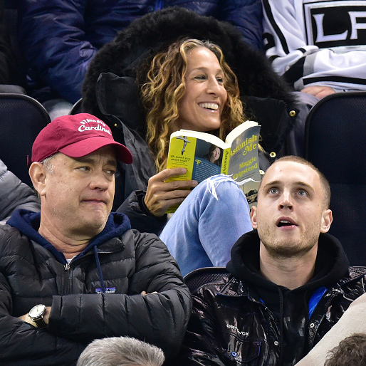 Tom Hanks and Sarah Jessica Parker were spotted at the Rangers vs. L.A. Kings game in New York City on March 24, 2015 - though SJP seemed much more enthused by her book than the hockey game!  (Photo: Getty Images)