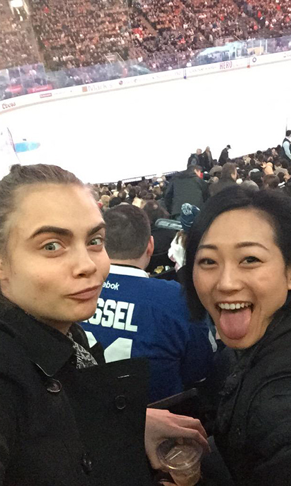 Cara's first hockey game! All she needed was a beer, a pal and a pair of nosebleed seats. Photo © Getty