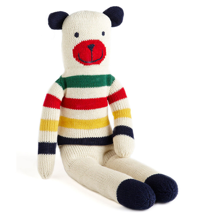 SOFT AND CUDDLY, THIS STRIPED BEAR IS A CRIB MUST-HAVE