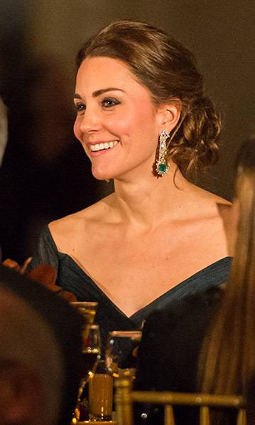 Kate may have recycled her Jenny Packham dress for the St. Andrews 600th Anniversary dinner in New York City, but she used the occasion to to show off a new pair of diamond-and emerald-earrings. They're said to have been a private gift with a matching bracelet.