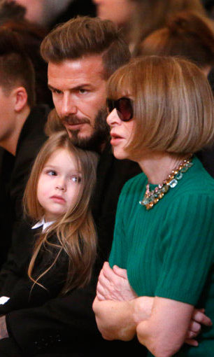 Gazing at Anna Wintour ahead of Victoria's catwalk show.
