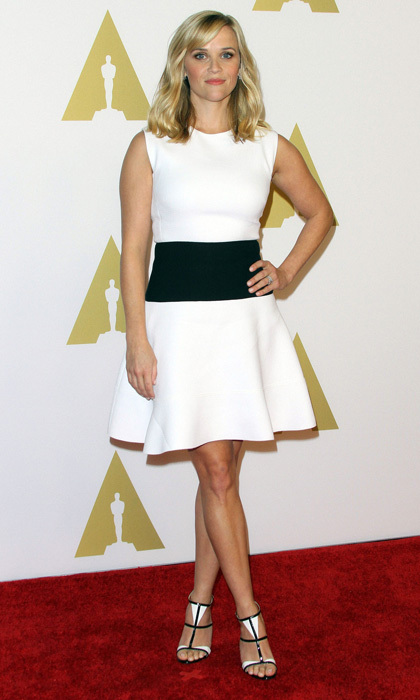 0615e72f9c91 Reese Witherspoon serves a stylish ace with a monochromatic dress and  coordinating heels. Photo