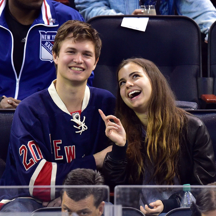 'Insurgent' star Ansel Elgort was teased by high-school sweetheart Violetta Komyshan on camera before the two kissed and munched on popcorn as the Rangers took on the Penguins on April 16, 2015. (Photo: Getty Images)