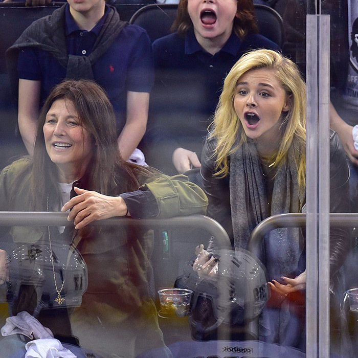 Catherine Keener and Chloe Grace Moretz couldn't contain their excitement during the playoffs on April 18, 2015, when the Pittsburgh Penguins beat the New York Rangers 4-3. (Photo: Getty Images)