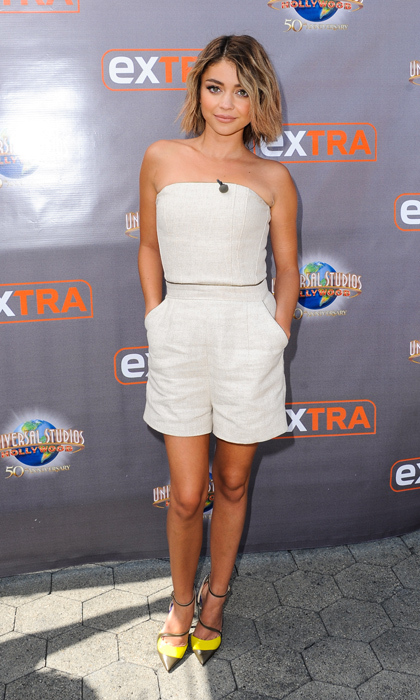 Sarah Hyland paid a visit to 'Extra' TV in a seasonally appropriate linen romper by Tamara Mellon and Jimmy Choo's pointed-toe, colour-block flats.