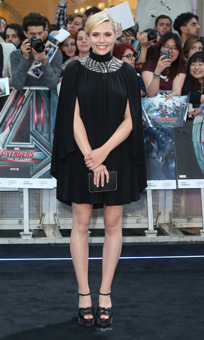 Elizabeth Olsen stepped out at the London premiere of 'The Avengers: Age of Ultron' in a sequin-collared cape dress by Saint Laurent and grommet-accented sandals.