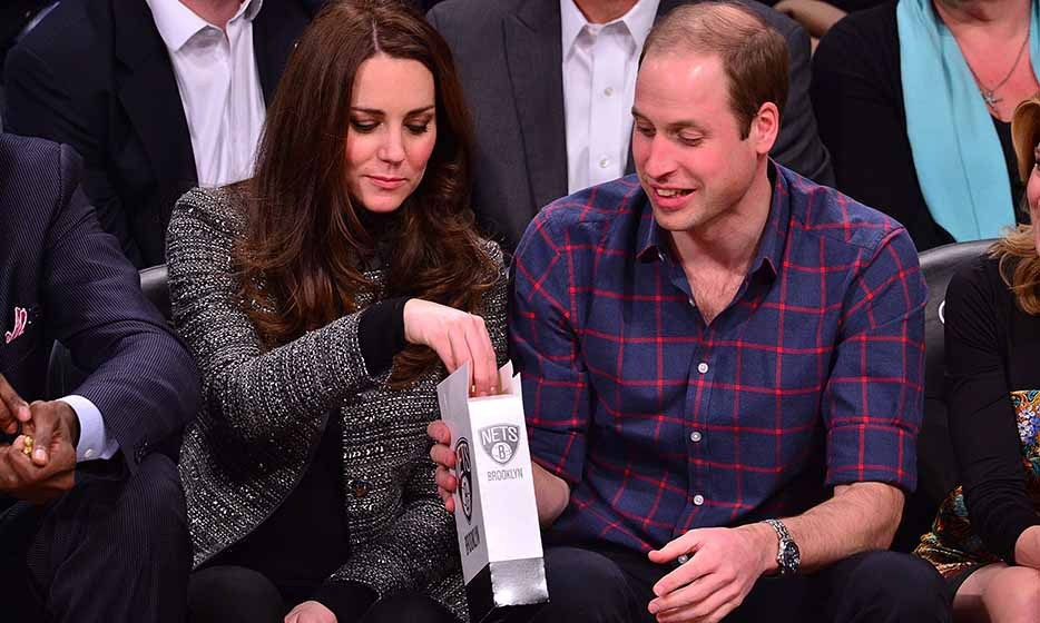They're just like us: The couple were spotted sharing a snack as they watched a Cleveland Cavaliers vs. Brooklyn Nets game in Brooklyn on Dec. 4, 2014.