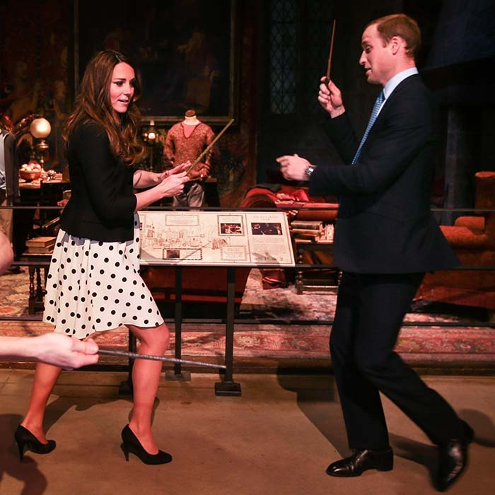 The playful pair pretended to challenge each other to a magical duel while visiting the 'Harry Potter' themed tour at Warner Bros. Studios in London.