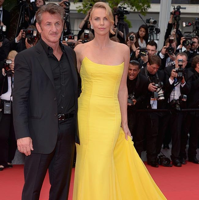 Sean Penn and Charlize Theron (in Dior). 