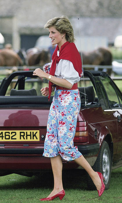 The princess was effortlessly chic in a pair of floral-print pants for a visit to the polo club. She colour-coordinated with her patent red shoes, belt and matching cardigan.