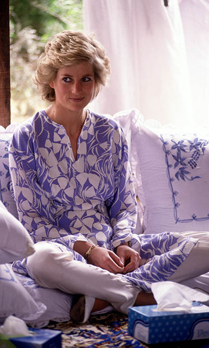 "The elegant royal kept cool in a blue-and-white outfit by <strong><a href=""/tags/0/catherine-walker"">Catherine Walker</a></strong> for a desert picnic in Saudi Arabia. 