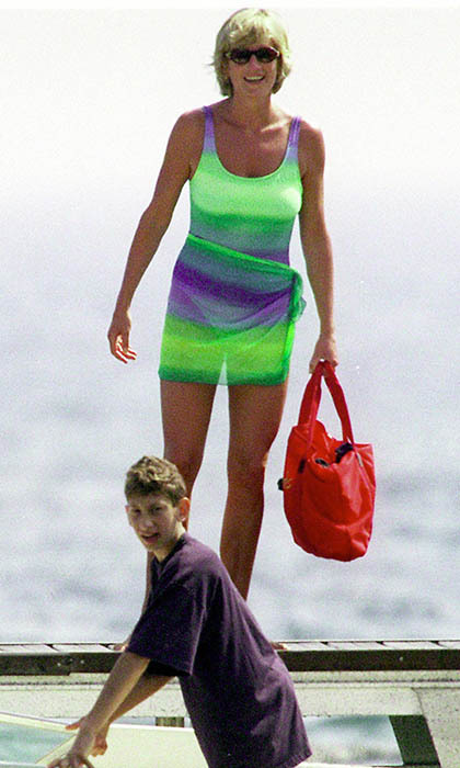 She was spotted aboard a yacht in St-Tropez wearing a purple-and-green swimsuit and matching sarong, which showed off her long, shapely legs.