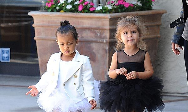 Penelope Disick contrasted her cousin's angelic look in an all-black ballet ensemble.