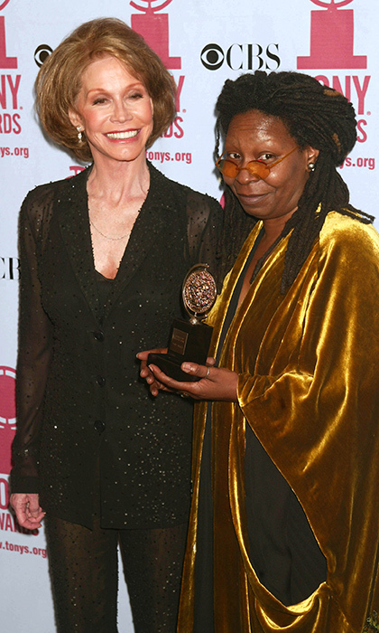 Whoopi Goldberg (pictured here with Mary Tyler Moore) is one of only 11 stars to secure the coveted EGOT (Emmy, Grammy, Oscar, Tony).  She fulfilled the Tony requirement in 2002 by producing the Best Musical winner 'Thoroughly Modern Millie'. 