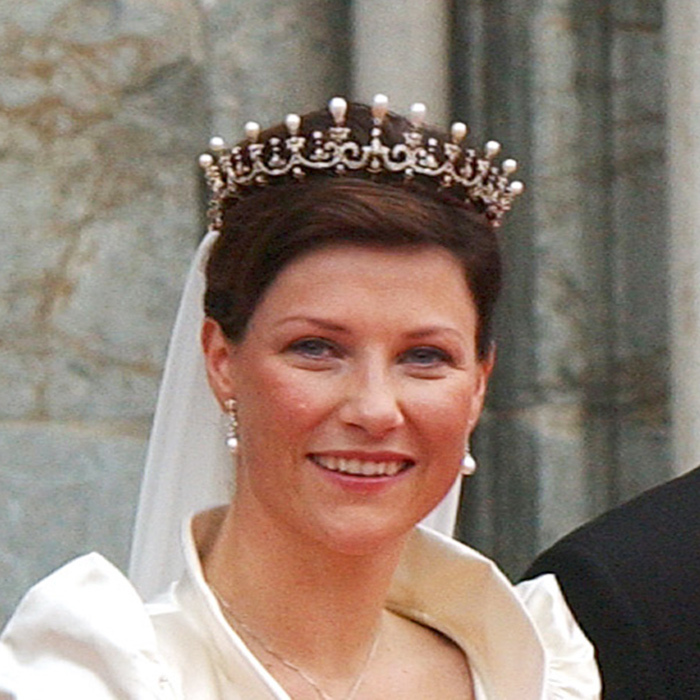 The Queen Maud's Pearl and Diamond tiara worn by the daughter of Norway's King Harald V and Queen Sonja - Princess Martha Louise - on her wedding day originated in the British monarchy. It belonged to Princess Maud, King Edward VII and Queen Alexandra's daughter, who married into Denmark's royal family. Her husband Carl later became the King of Norway, subsequently passing the tiara down to Martha Louise.
