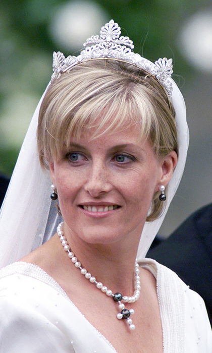 When Britain's Prince Edward married Sophie Rhys-Jones in 1999, royal enthusiasts were surprised she donned a never-before-seen tiara. It turns out the scrollwork-motif diamond band came from the Queen's private collection. Its exact origins have never been confirmed by Buckingham Palace.