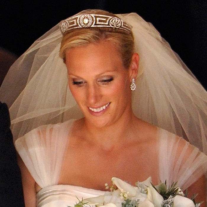 Princess Anne's only daughter, Zara Phillips, married rugby-star love Mike Tindall in 2011 in a gown designed by one of the Queen's couturiers, Stewart Parvin. She accessorized her silk veil with her mother's Meander tiara. The headpiece originated in Greece's royal family, with Prince Philip's mother Alice gifting the tiara to the Queen on her wedding day - and the Queen subsequently passing it on to her daughter, Princess Anne.