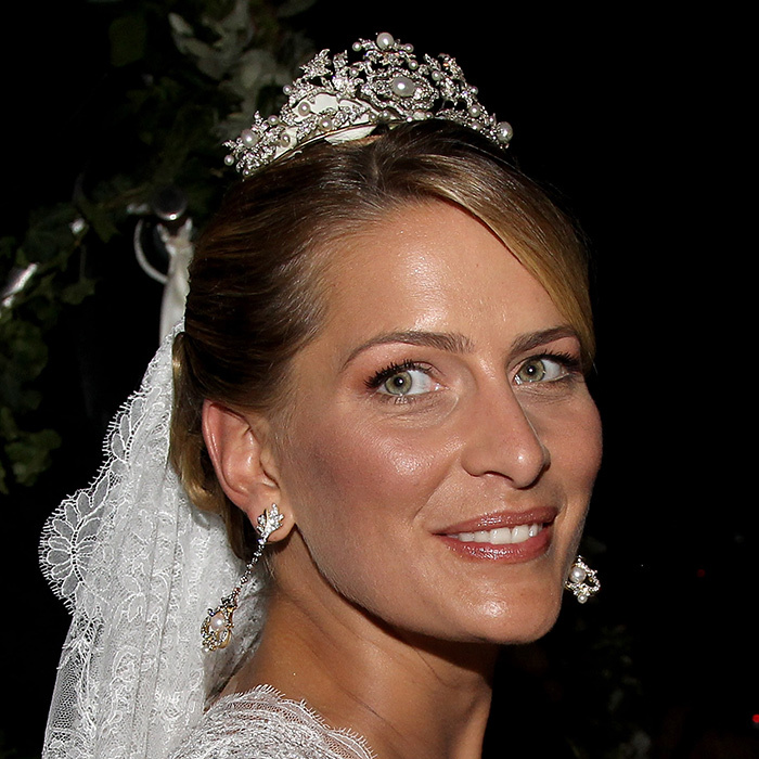 Venezuelan-born Princess Tatiana of Greece and Denmark wore the same diamond-and-pearl Fringe tiara that Princess Marie-Chantal wore on her wedding day 15 years prior.