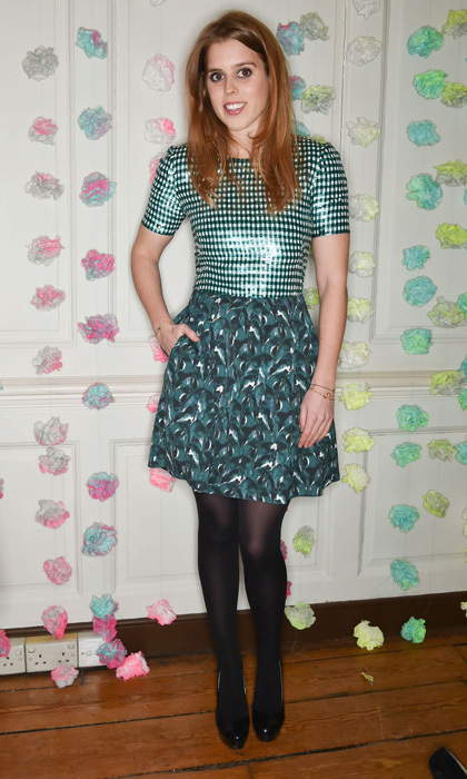 Princess Beatrice dazzles in a sequin-adorned gingham T-shirt and printed skirt.