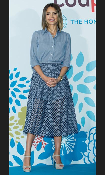 Casual yet chic, Jessica Alba paired her Michael Kors gingham skirt with a loose-fit chambray top.