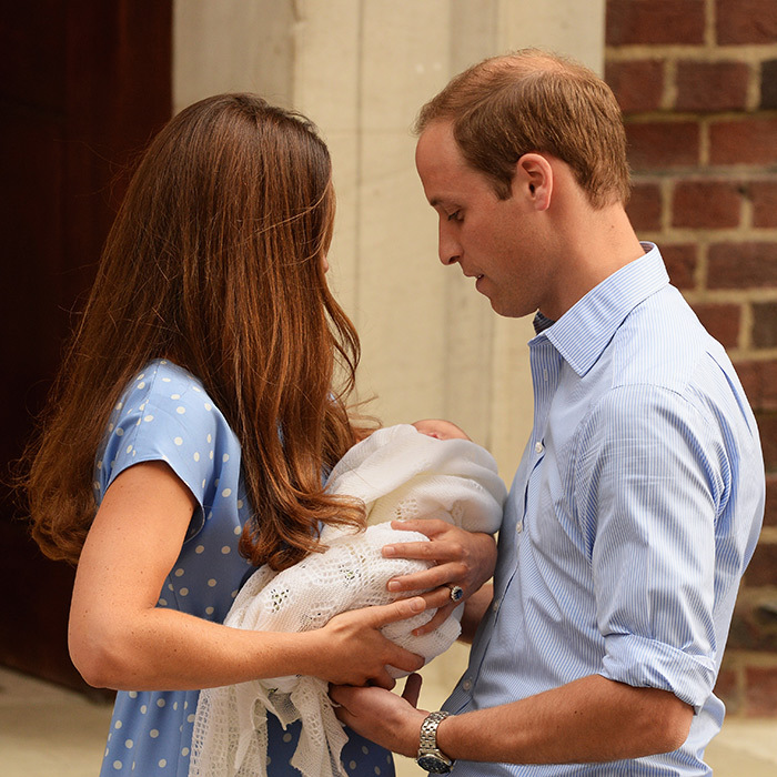 Kate gently passes her newborn son to his father outside the Lindo Wing at St. Mary's Hospital after his birth on July 22, 2012.