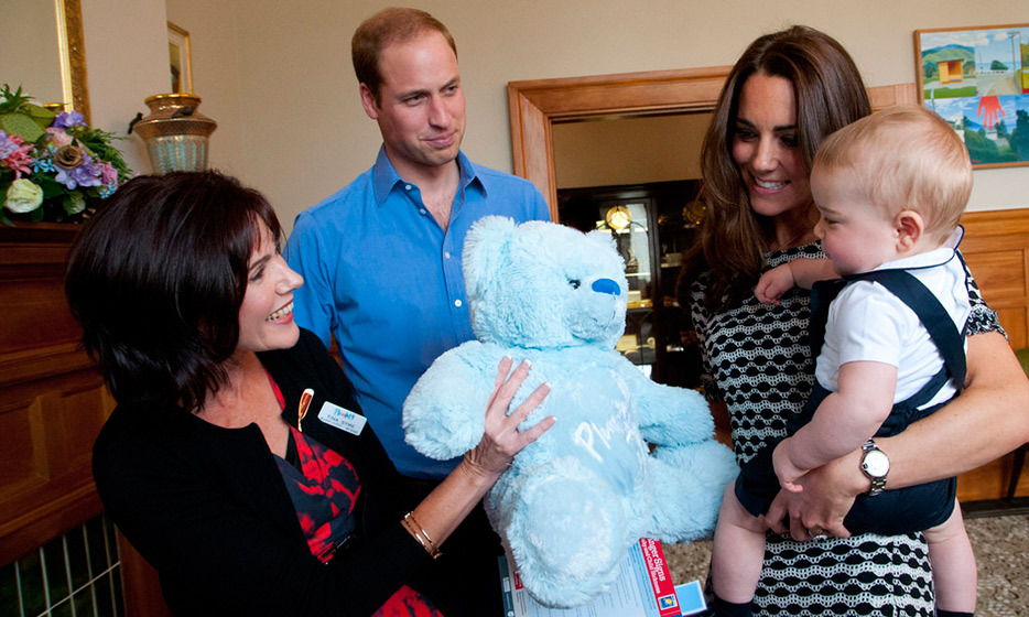 Prince William proudly looks on as his son is presented with a special plush teddy in New Zealand.