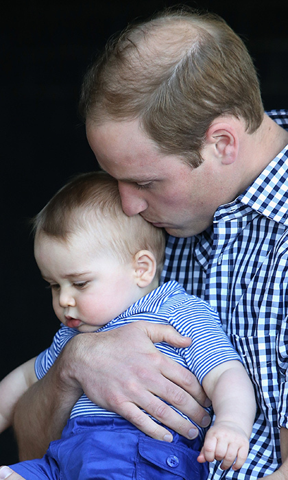A content Prince George enjoys some kisses from dad.
