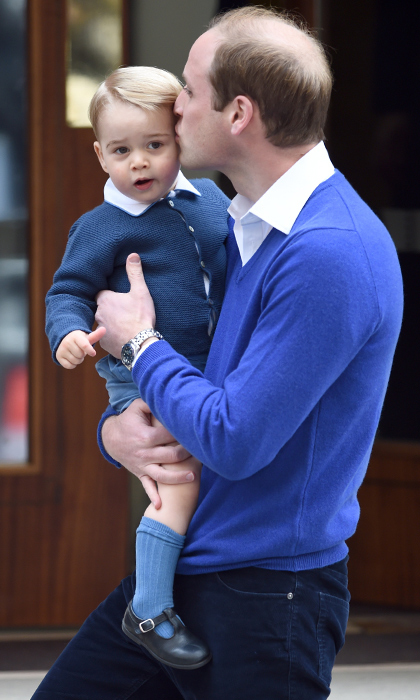 With a kiss on the forehead from dad, Prince George is ready to go inside St. Mary's Hospital to meet his newborn baby sister.