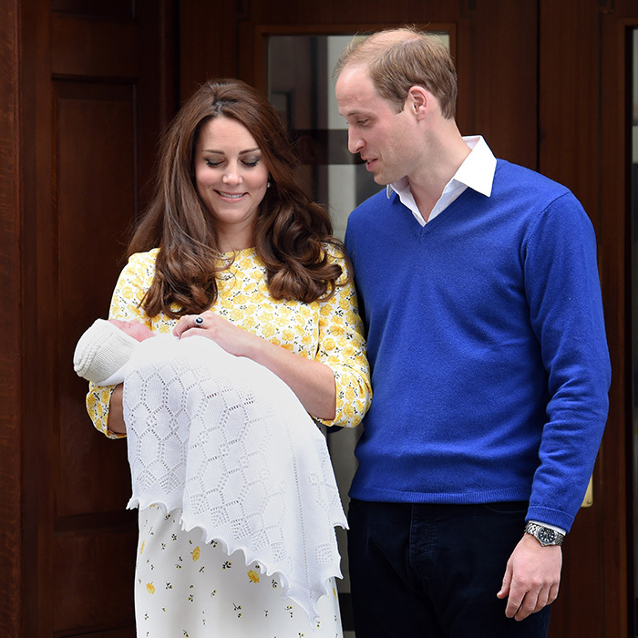 The new father can't keep his eyes off his newborn daughter, Princess Charlotte.