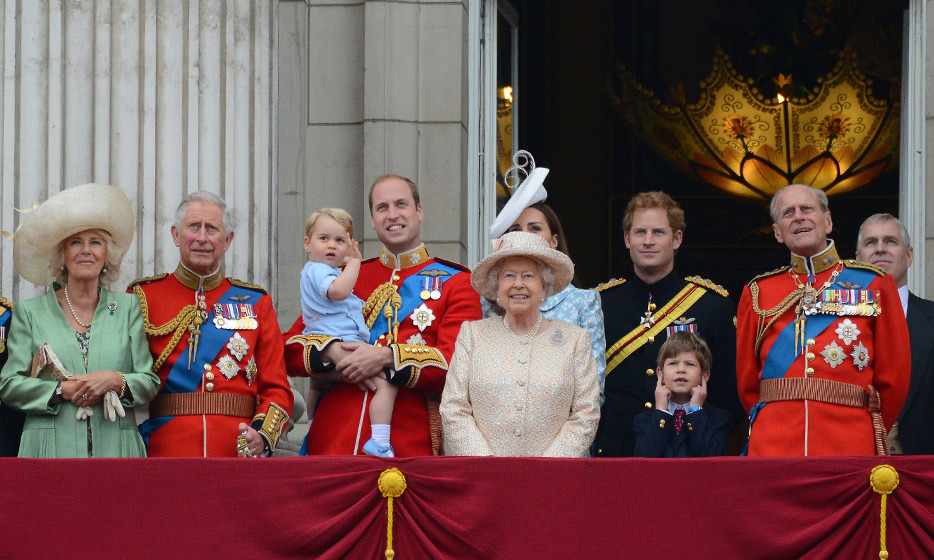 Safe in the arms of his father, Prince George makes his debut at 2015's Trooping the Colour celebrations.