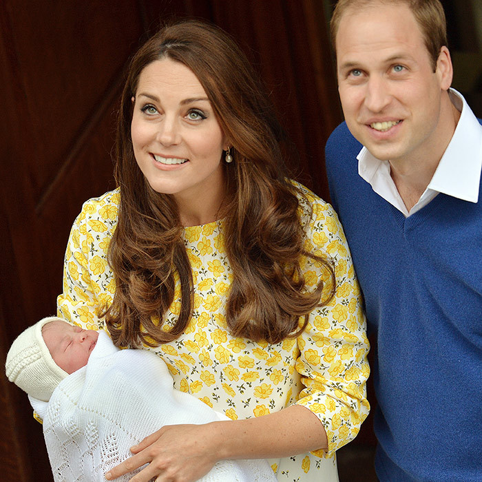 The royal couple spot well-wishers outside St. Mary's Hospital following Charlotte's birth.