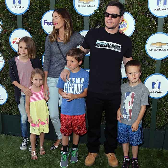 Most of his movies might not be family friendly, but Mark Walhberg is 100 per cent family man. The Boston native has four children with wife Rhea Durham - daughters Grace and Ella and sons Brendan and Michael.