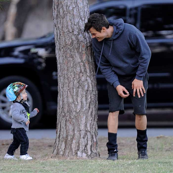 "Here, Josh Duhamel plays around with son Axl during a day out at the park. The actor told 'Women's Health' magazine that, ""Fatherhood is transformational. My problem is that I'm not very productive anymore, because I always want to be there when he gets up."" 
