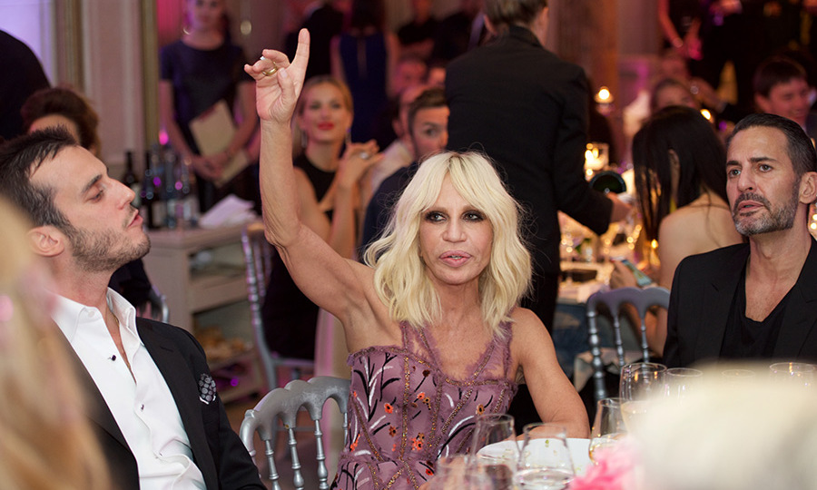 Donatella Versace bids on a snap of her late brother Gianni.