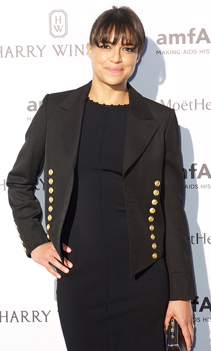Michelle Rodriguez shunned the night's trendy florals for an all-black ensemble.